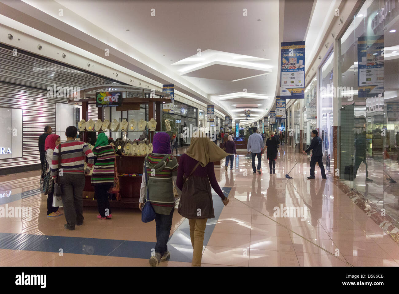 customers shopping mall of arabia cairo juhayna square 6th of stock photo royalty free image. Black Bedroom Furniture Sets. Home Design Ideas