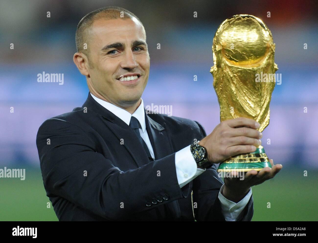 Italian captain Fabio Cannavaro holds up the World Cup Trophy