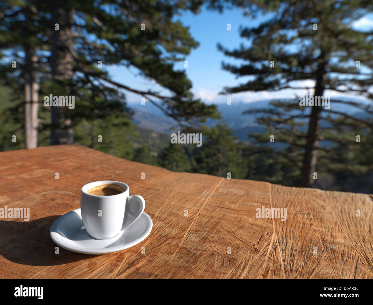 A cup of greek coffee on a wooden table in the forest stock photo a cup of greek coffee on a wooden table in the forest geotapseo Gallery