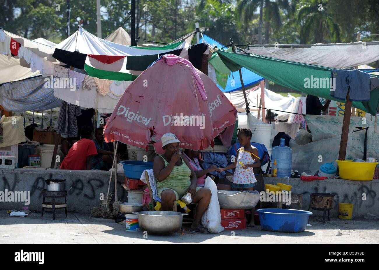 Survivors pictured in a tent colony in Port-au-Prince Haiti 18 & Survivors pictured in a tent colony in Port-au-Prince Haiti 18 ...