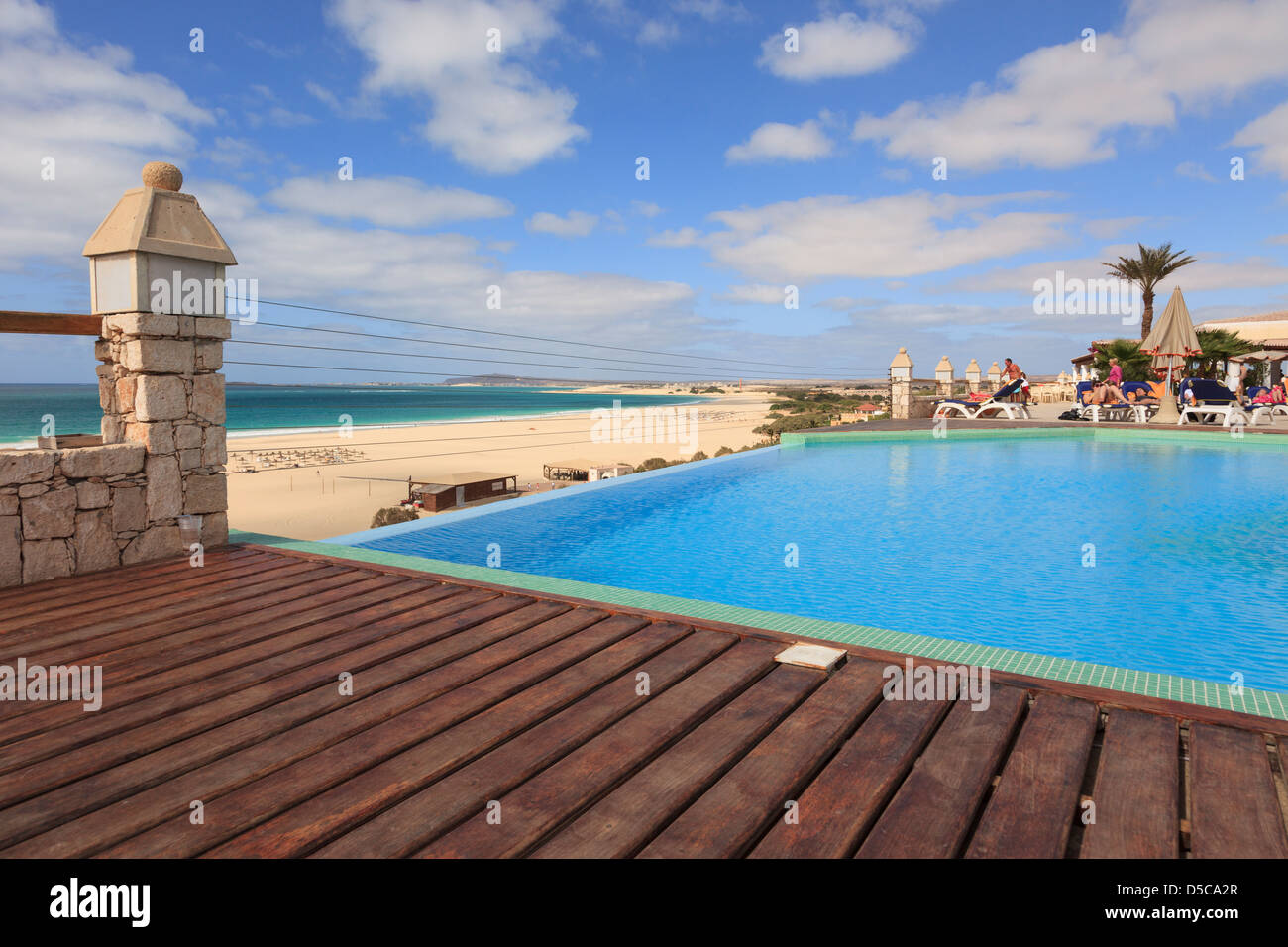 Wooden sun decking by infinity pool in Iberostar resort