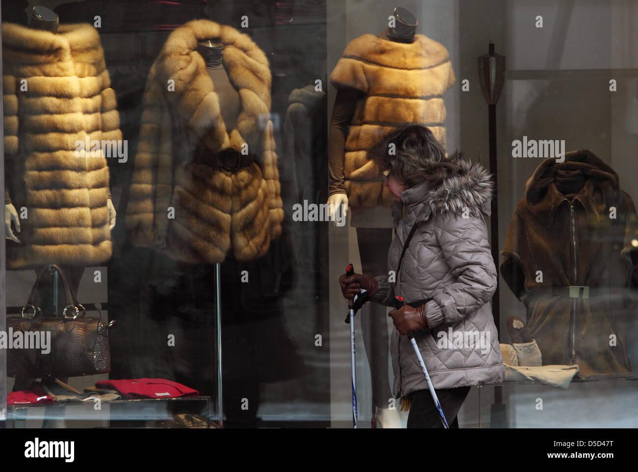 St. Moritz, Switzerland, fur coats woman looks at a shop window ...