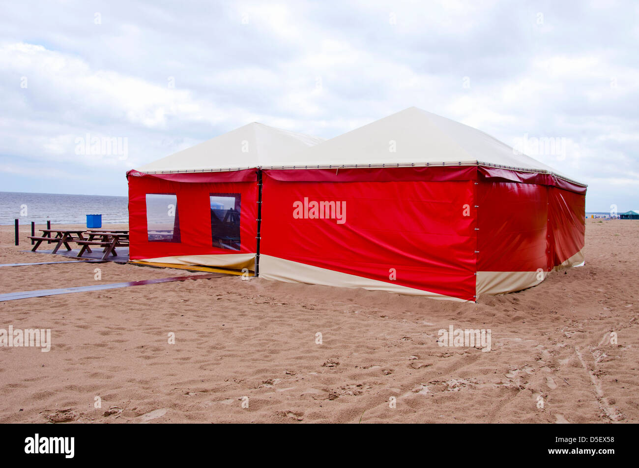 red summer resort cafe tent on sea beach in morning & red summer resort cafe tent on sea beach in morning Stock Photo ...
