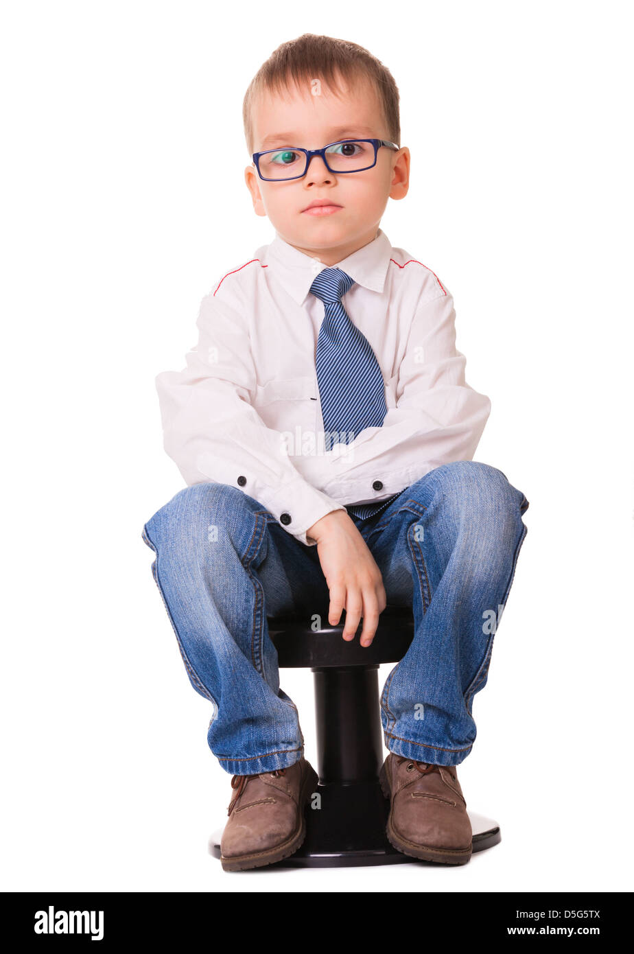 Black child sitting in chair - Small Sad Boy In Glasses Shirt And Jeans Sitting On The Black Chair Isolated On White Background