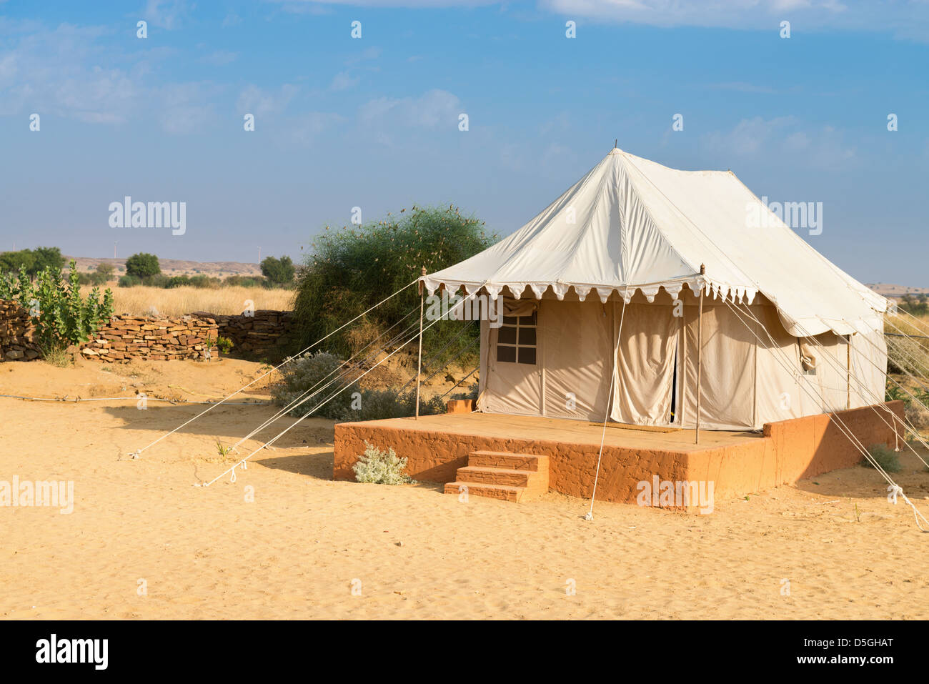 Tent in c&ing site hotel for tourist in the thar desert under blue sky & Tent in camping site hotel for tourist in the thar desert under ...