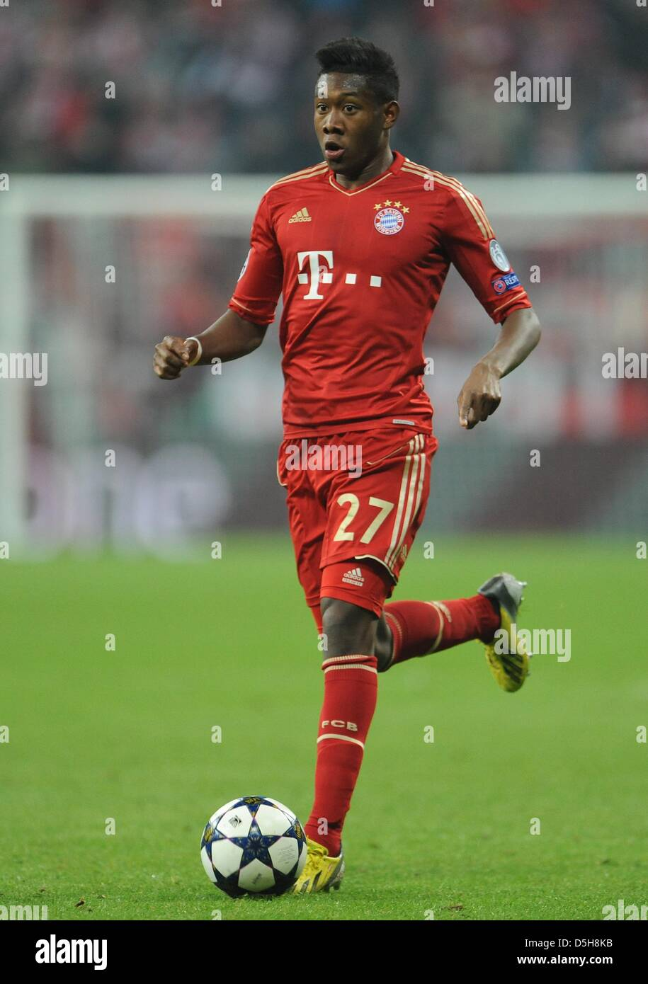Munich s David Alaba runs with the ball during the UEFA Champions