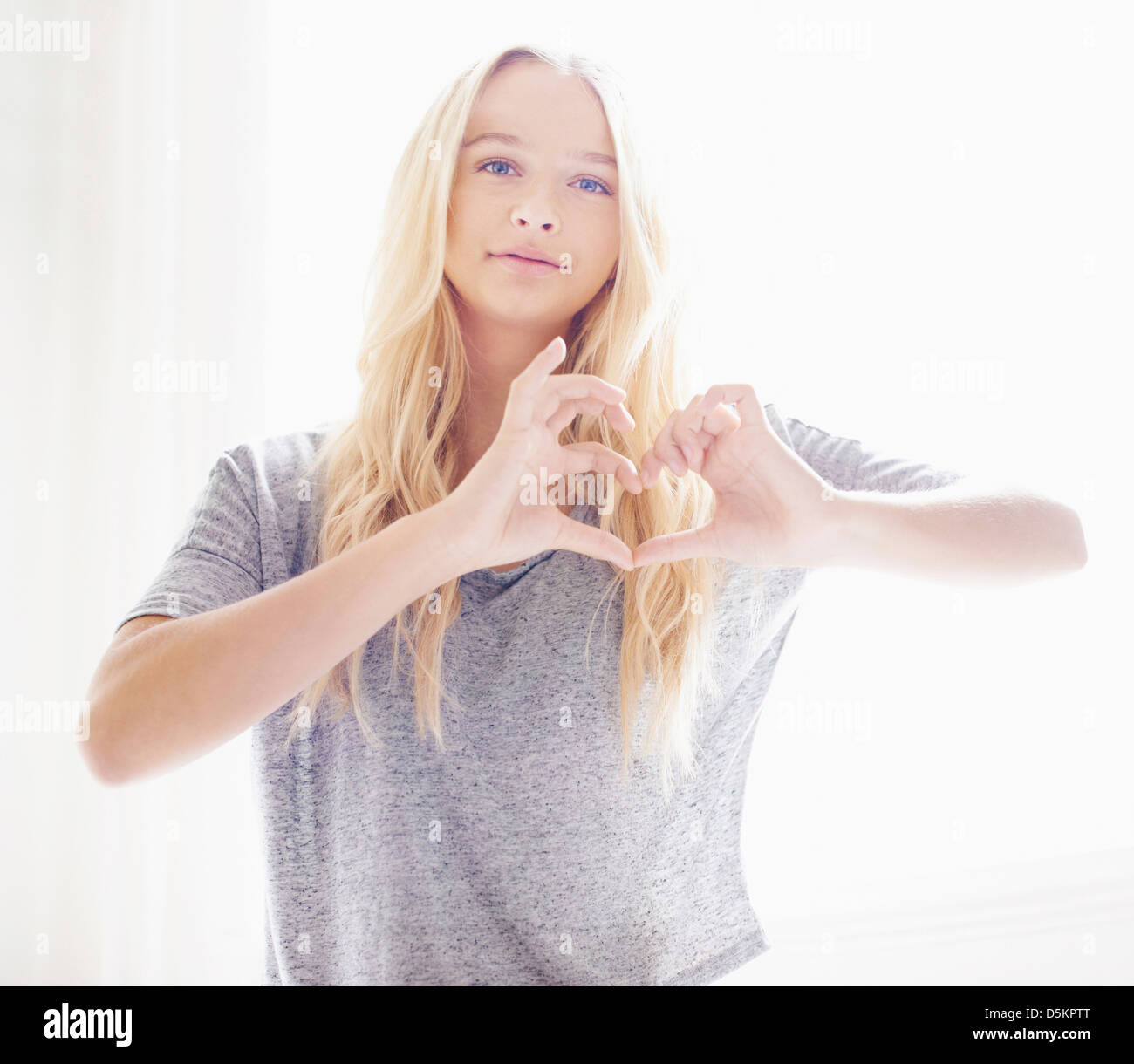 Portrait of teen (16-17) girl making heart shape with hands Stock ...