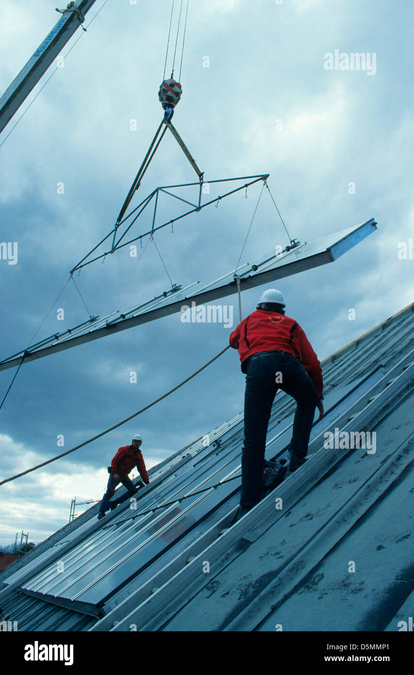 germany hamburg bramfeld installation of solar thermal collector by stock photo royalty free. Black Bedroom Furniture Sets. Home Design Ideas