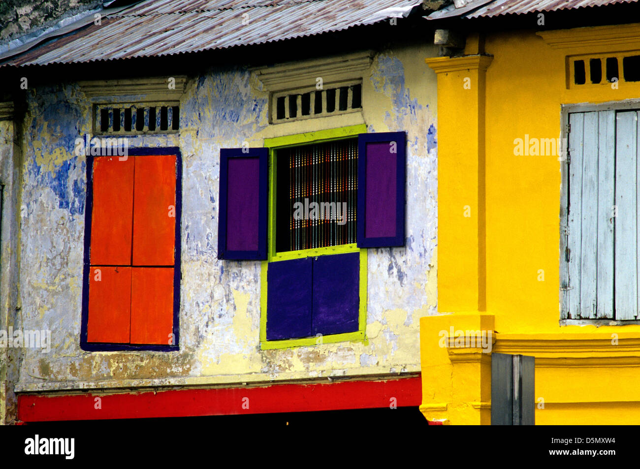 Stock photo street view of colorful windows and doors of houses in little india singapore