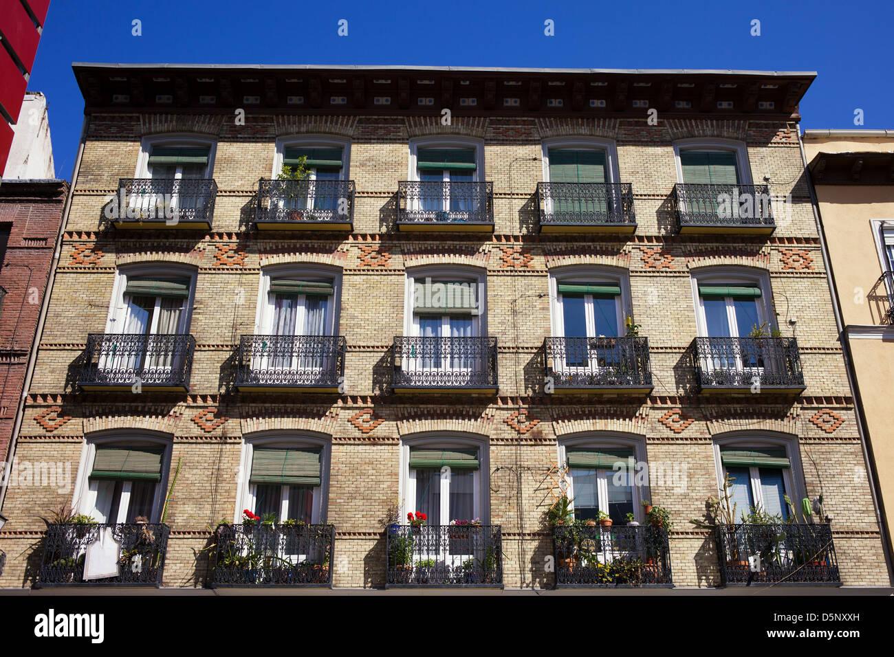 Old Apartment Building With Balconies Brick Facade In Madrid Old Apartment  Building With Balconies Brick Facade