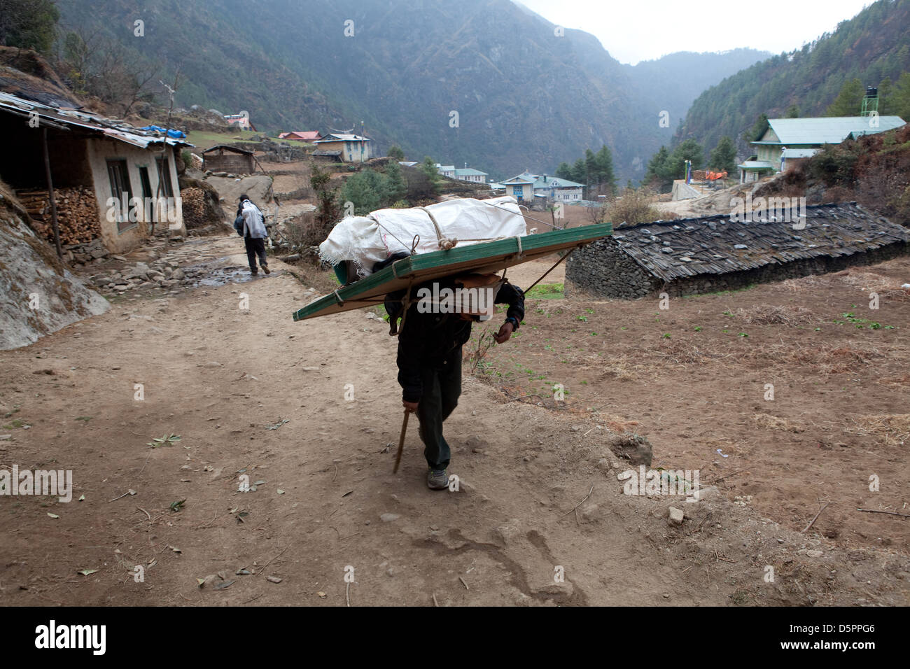 Sherpa carrying a heavy load Stock Photo, Royalty Free ...