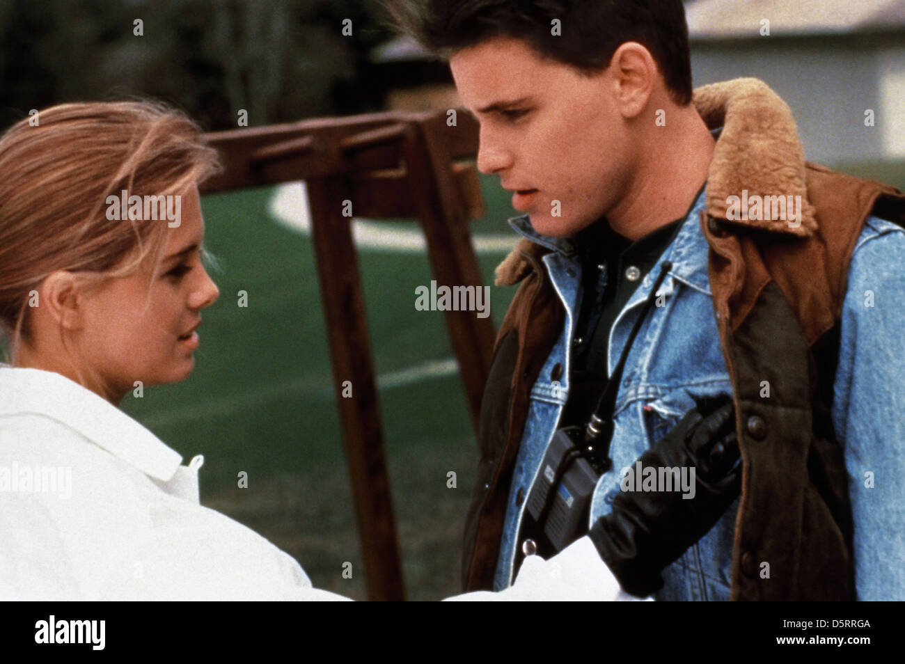 NICOLE EGGERT & COREY HAIM BLOWN AWAY (1993 Stock Photo ...