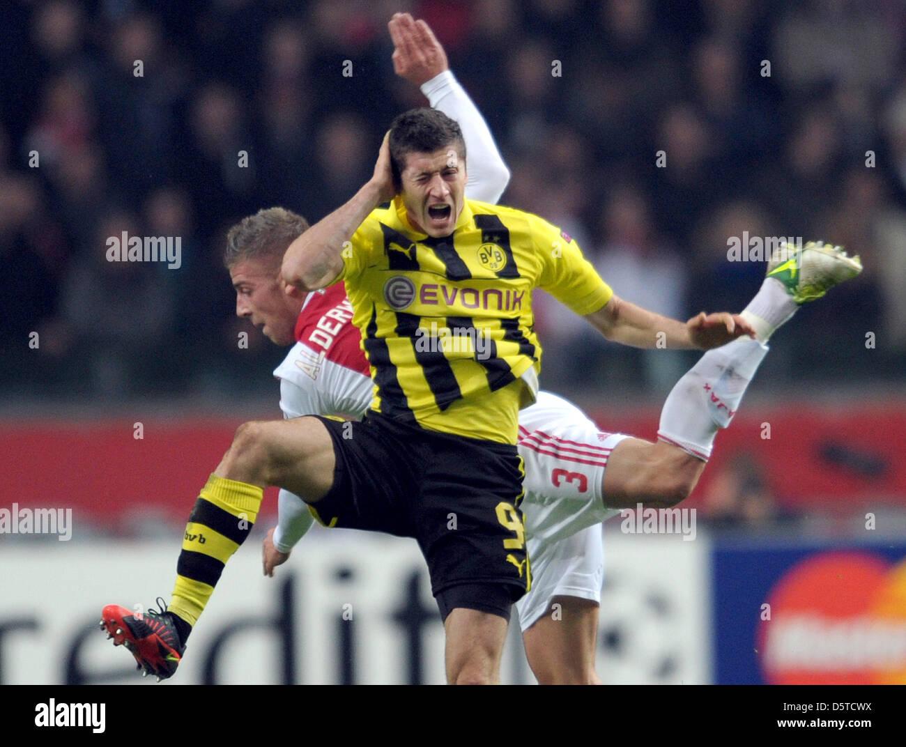 Dortmund s Robert Lewandowski front and Toby Alderweireld of