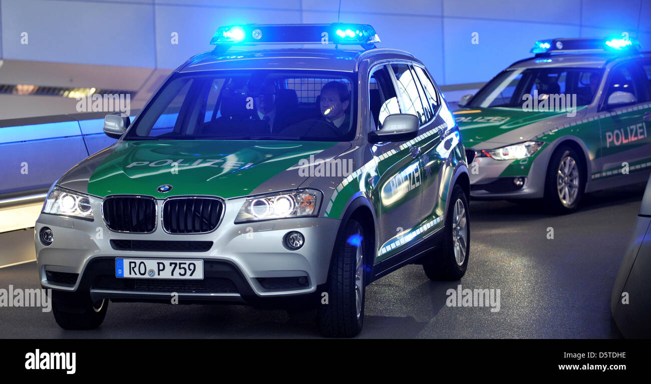 Bavarian police officers ride their new bmw police cars in munich germany 22 november