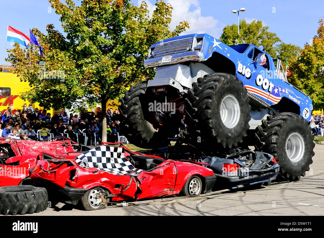 Monster Trucks Drive Over Old Cars At The Monster Truck Show In
