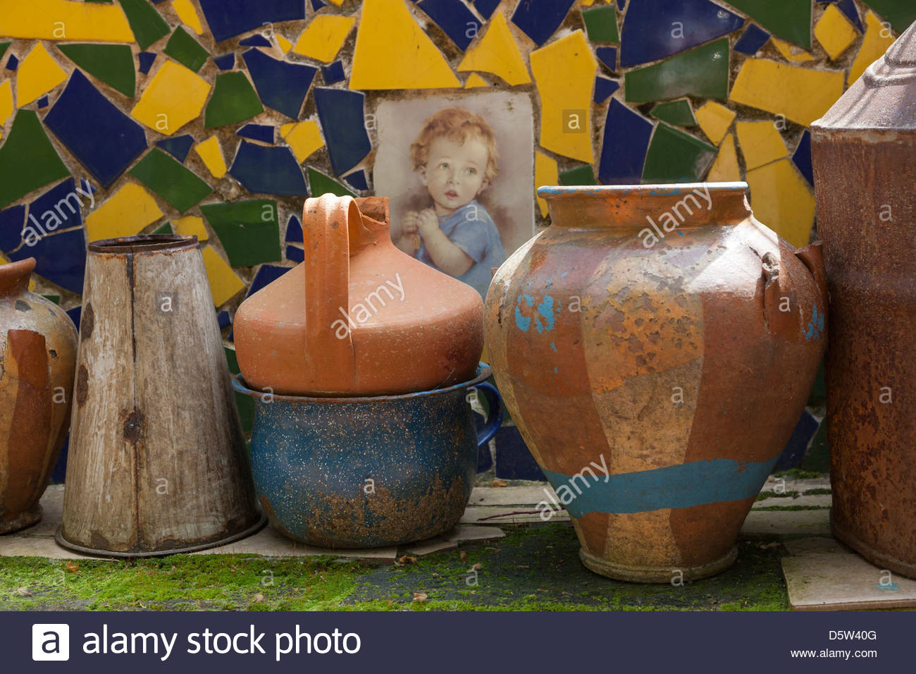 Vases and pots gallery vases design picture mixed old pots jugs and vases on a low brick wall backed by a mixed old reviewsmspy