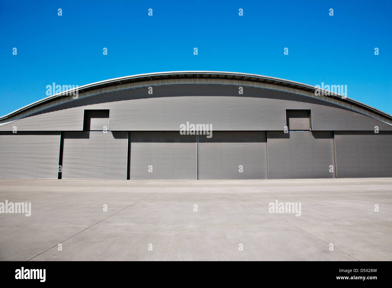 Lovely Curved Roof Of Warehouse And Blue Sky   Stock Image