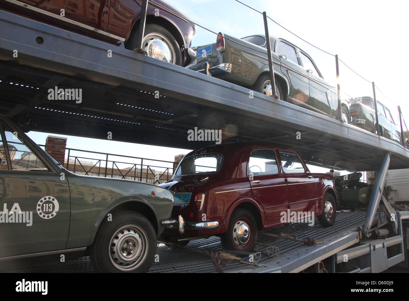 classic vintage cars on the back of a transport truck lorry Stock ...