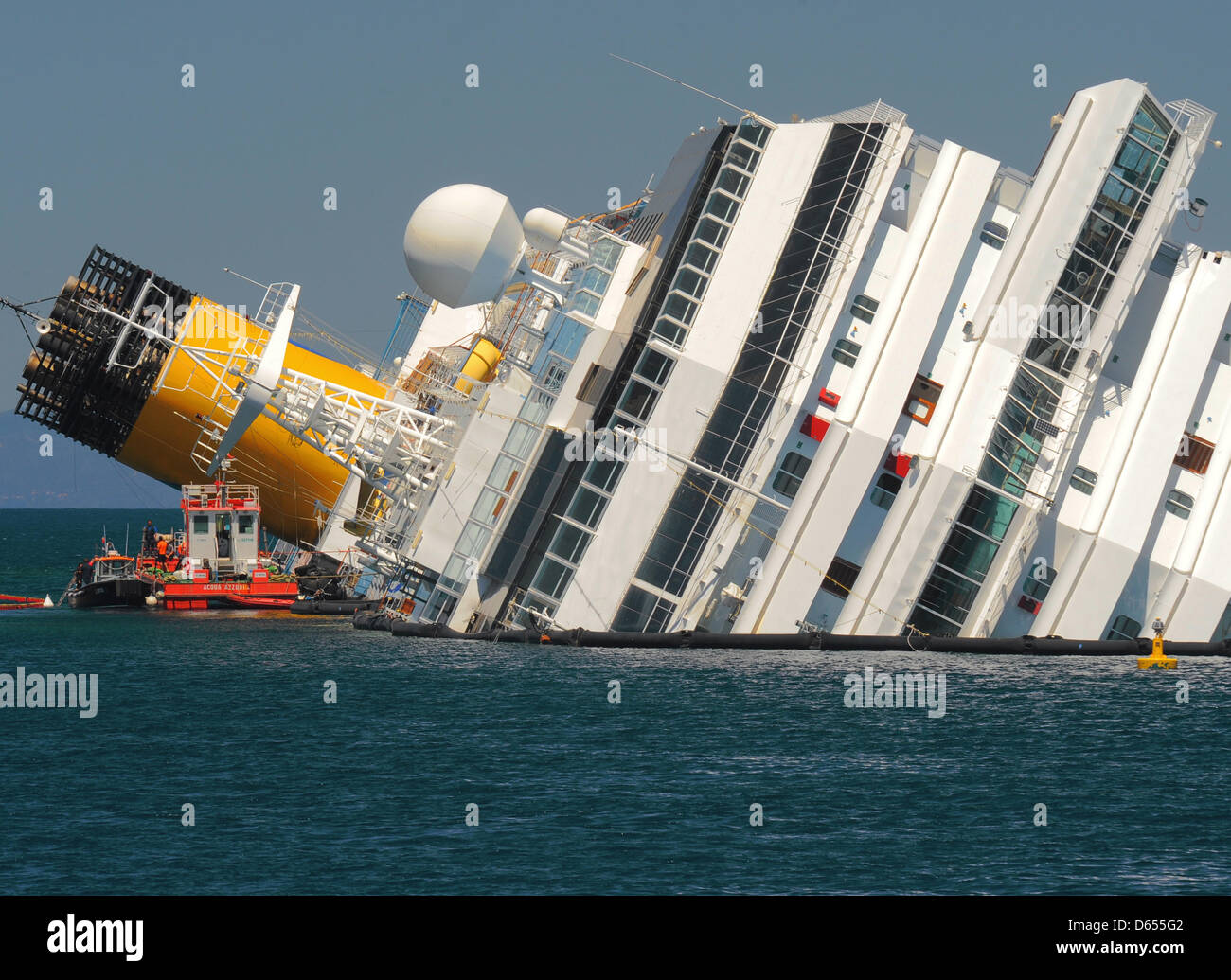 The Capsized Costa Concordia Cruise Ship Lies Off The Port Of - Sunken cruise ships