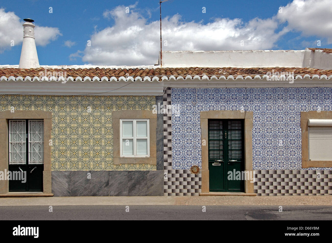 Painted tin-glazed ceramic Azulejos tiles decorating houses in a ...