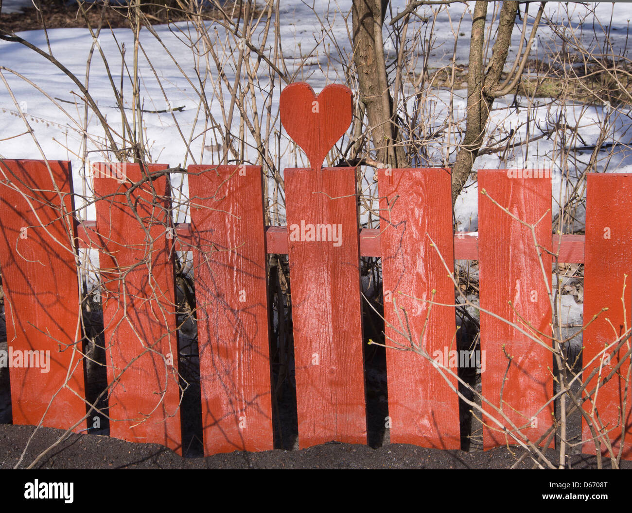 red-wooden-fence-with-carved-out-heart-o