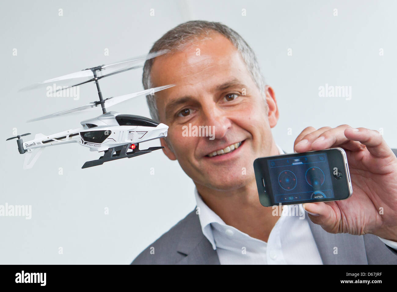 Stock Foto - The head of the Vedes AG, <b>Achim Weniger</b>, presents a toy ... - the-head-of-the-vedes-ag-achim-weniger-presents-a-toy-helicopter-by-D67JRF