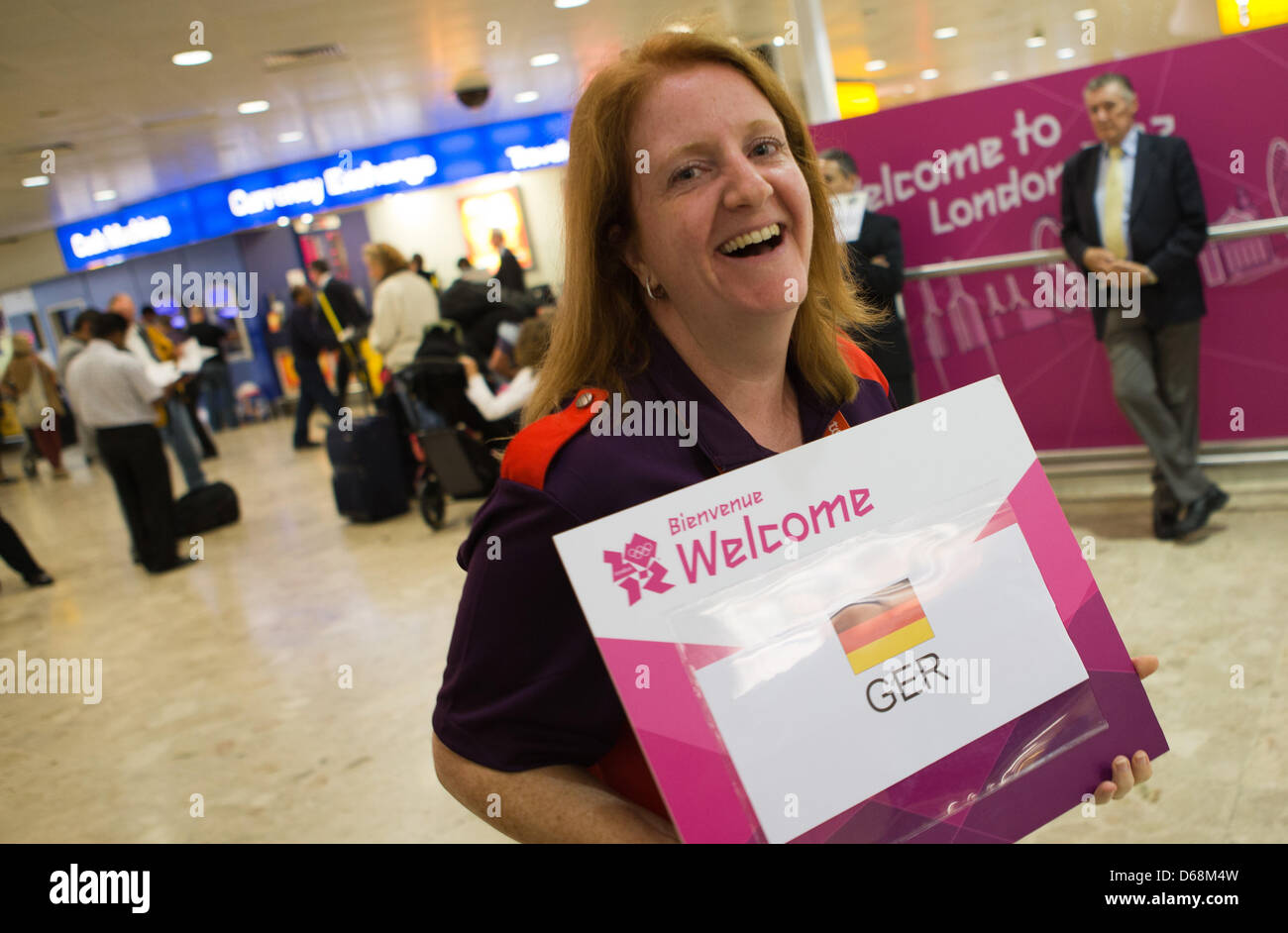 Sophie hannaford from the meet and greet team welcomes guests at sophie hannaford from the meet and greet team welcomes guests at heathrow airport in london great britain 18 july 2012 the london 2012 olympic games kristyandbryce Image collections