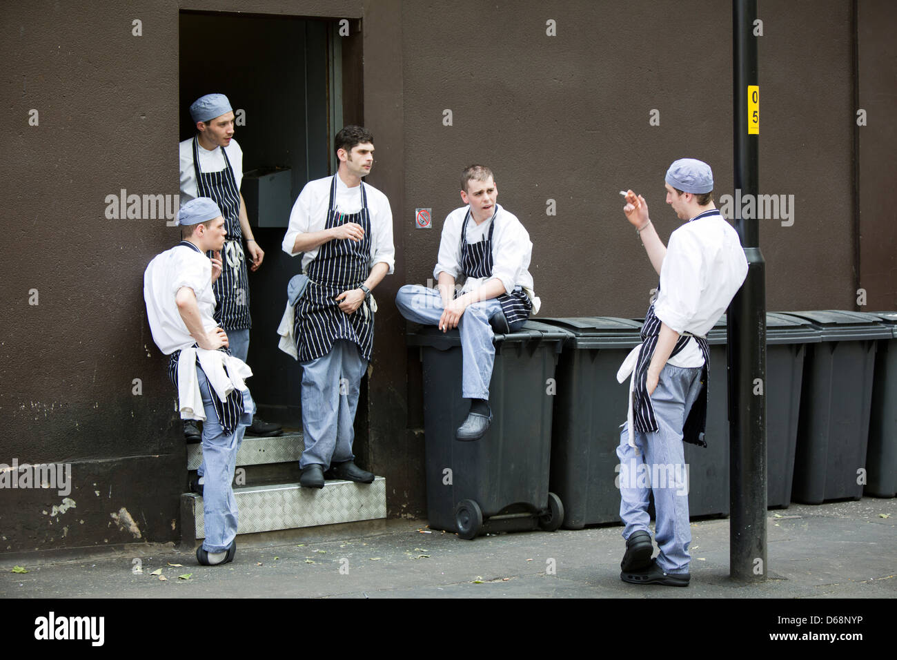 Restaurant Kitchen Staff manchester uk bar & grill chefs kitchen staff take a smoking break