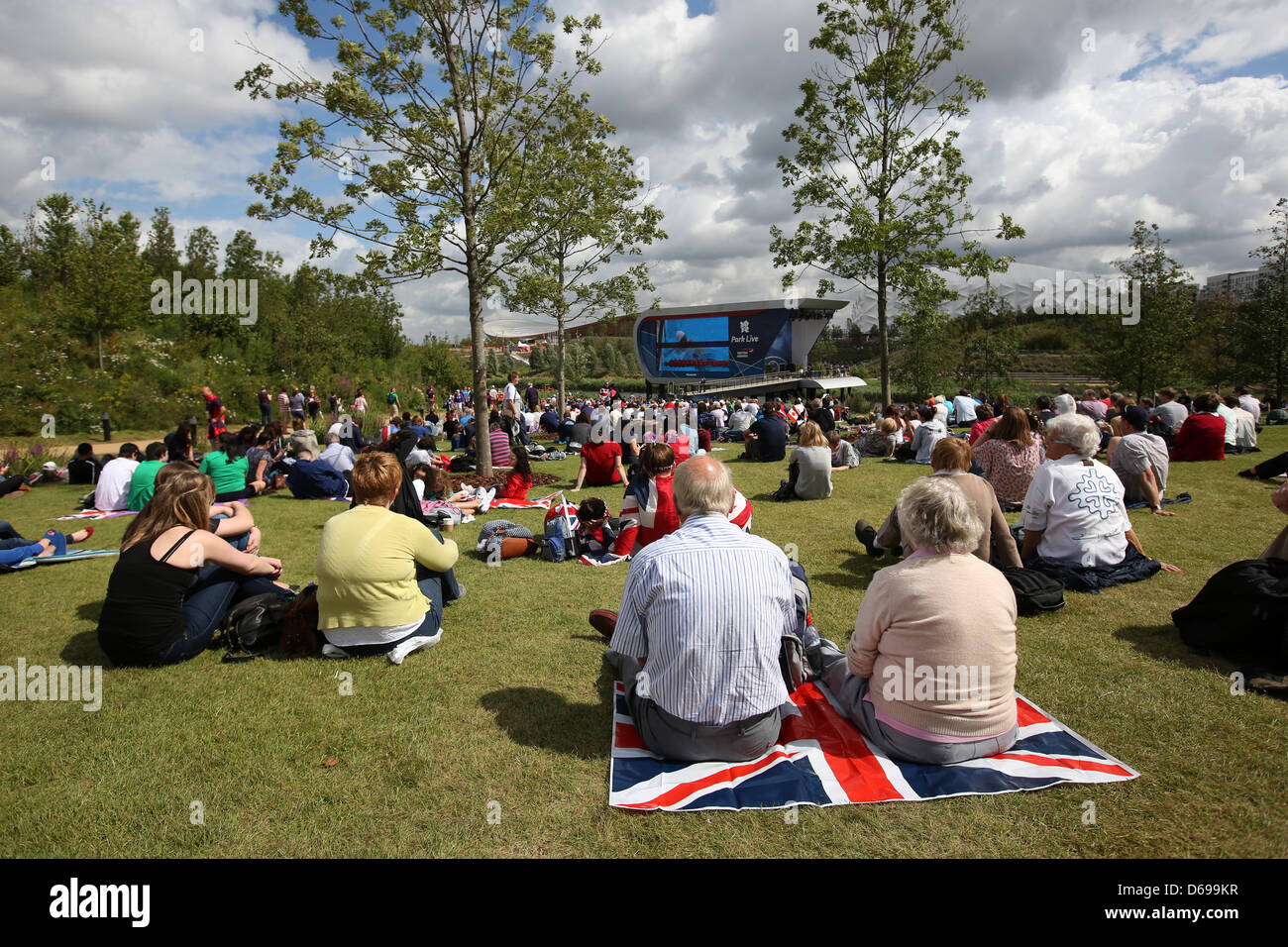 People Sit In The Olympic Park And Watch Swimming Event On A Huge TV Screen Seventh Day Of London 2012 Games Britain