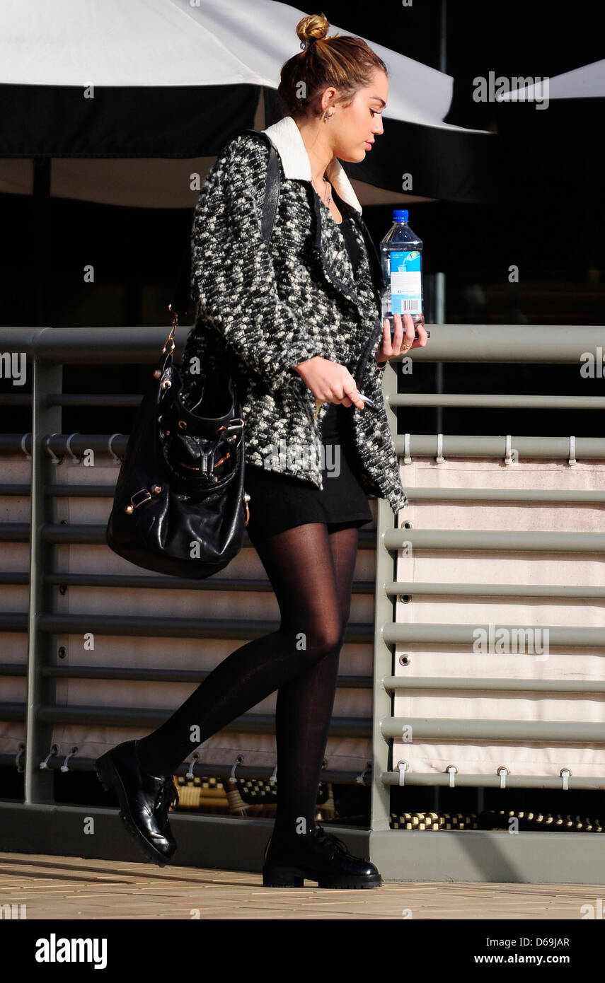 charming California Pizza Kitchen Studio City #3: Miley Cyrus carrying a bottle of Fiji Water as she leaves California Pizza Kitchen in Studio City Los Angeles, California -