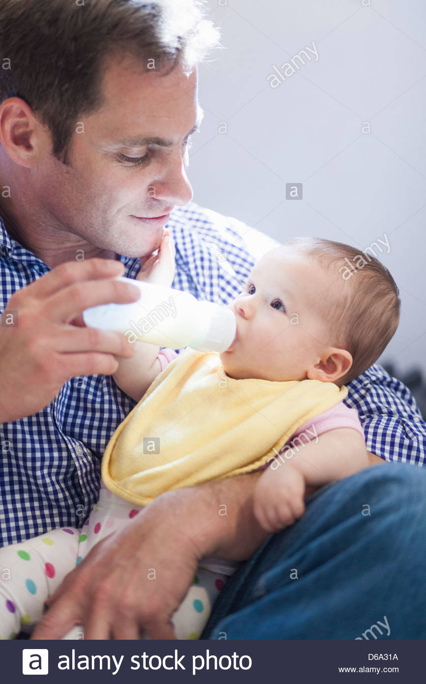 Father feeding baby daughter bottle Stock Photo, Royalty ...