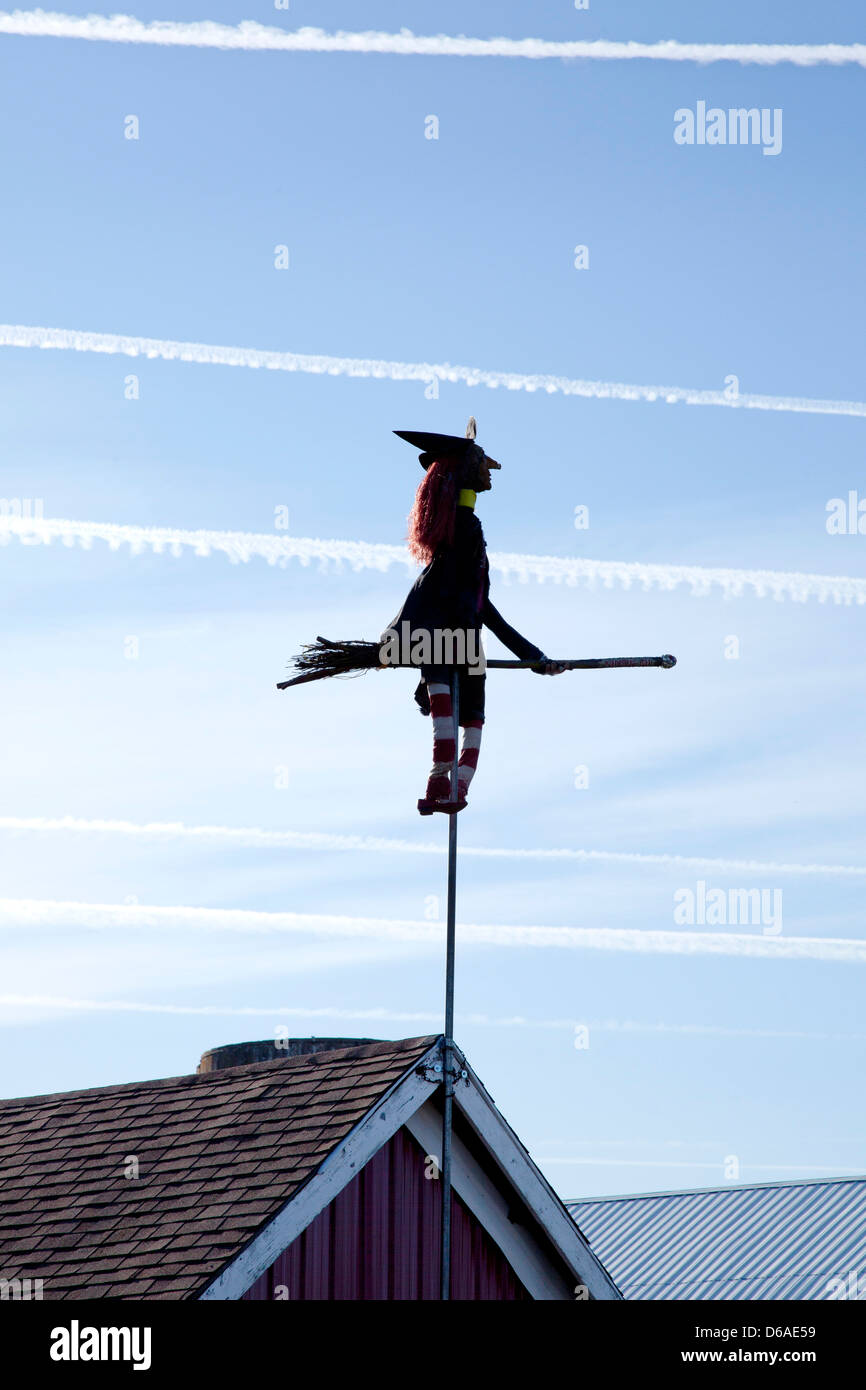 Stock Photo - Witch and Broom on Pole Attached to Barn Roof with Airplane Trails in Sky & Witch and Broom on Pole Attached to Barn Roof with Airplane Trails ... memphite.com