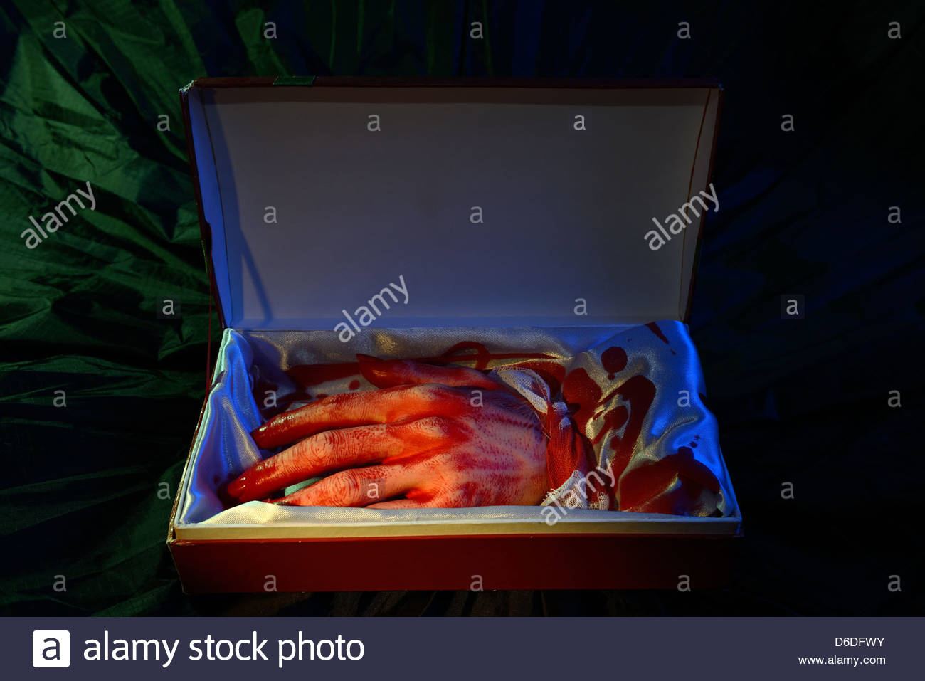 Cut bloody hand in open gift box. Blackmai, asking for ransom ...