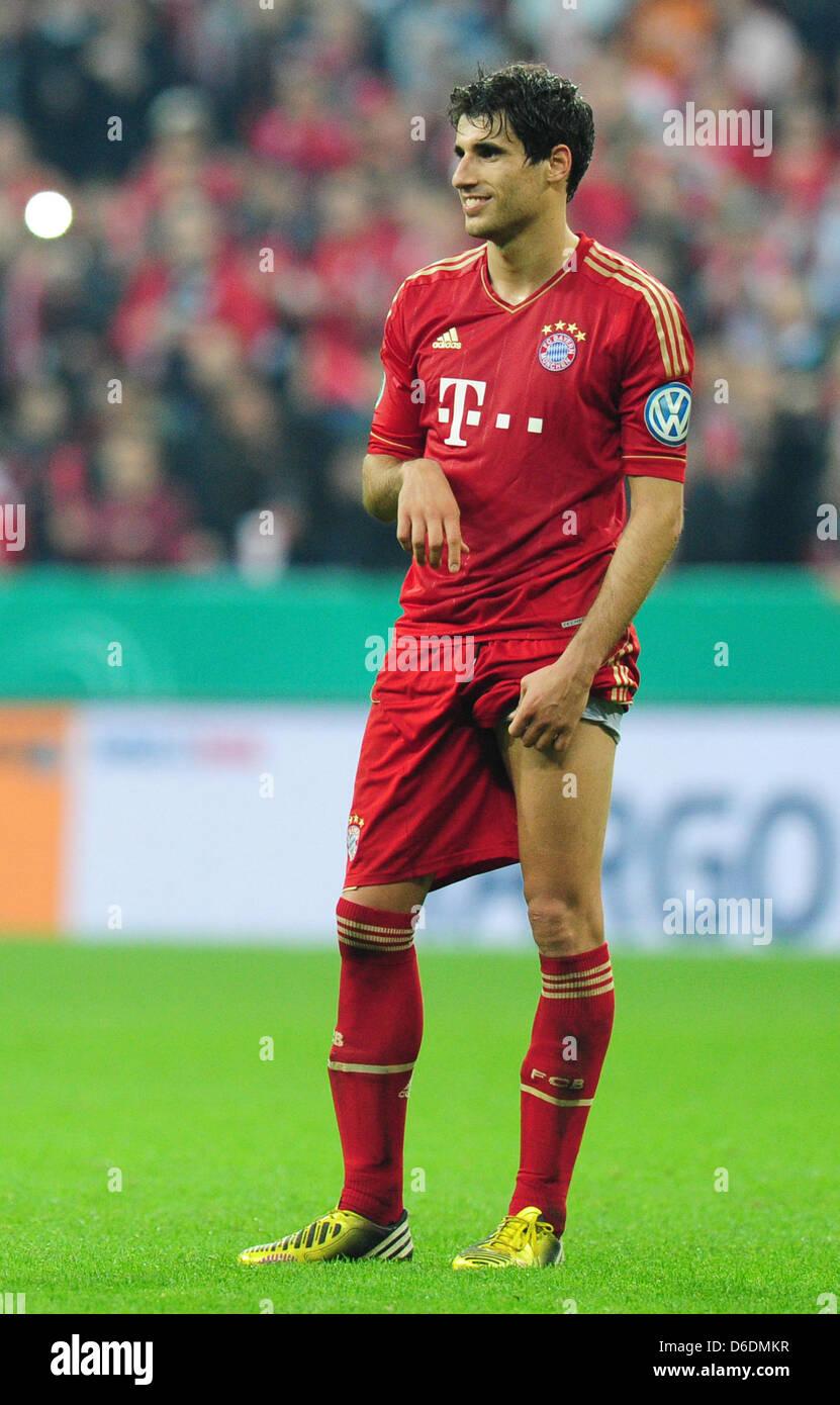 Munich s Javi Martinez gestures during the DFB Cup semi final