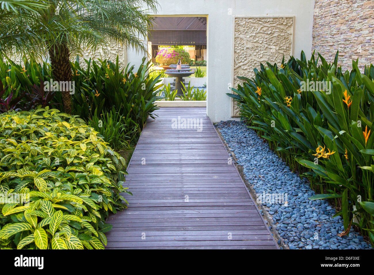 Beautifully manicured tropical garden design at the ocean for Tropical home garden design