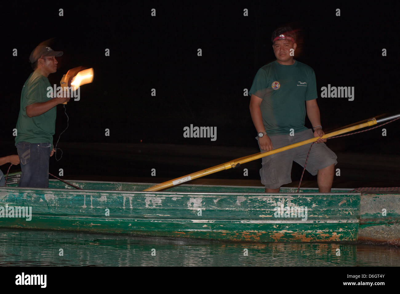 Guide And Researcher On A Boat Out Lamping For Caiman With Spotlight With  The Intention Of Catching Individuals Data Collection