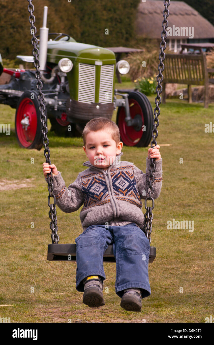 3 Year Old Child Swinging On A Swing Stock Photo, Royalty Free ...