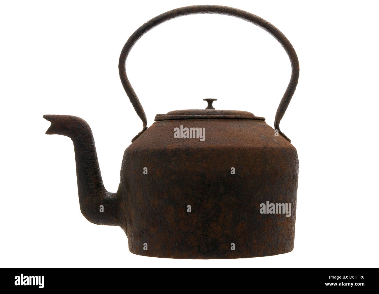 old rusty cast iron stove top kettle on white background