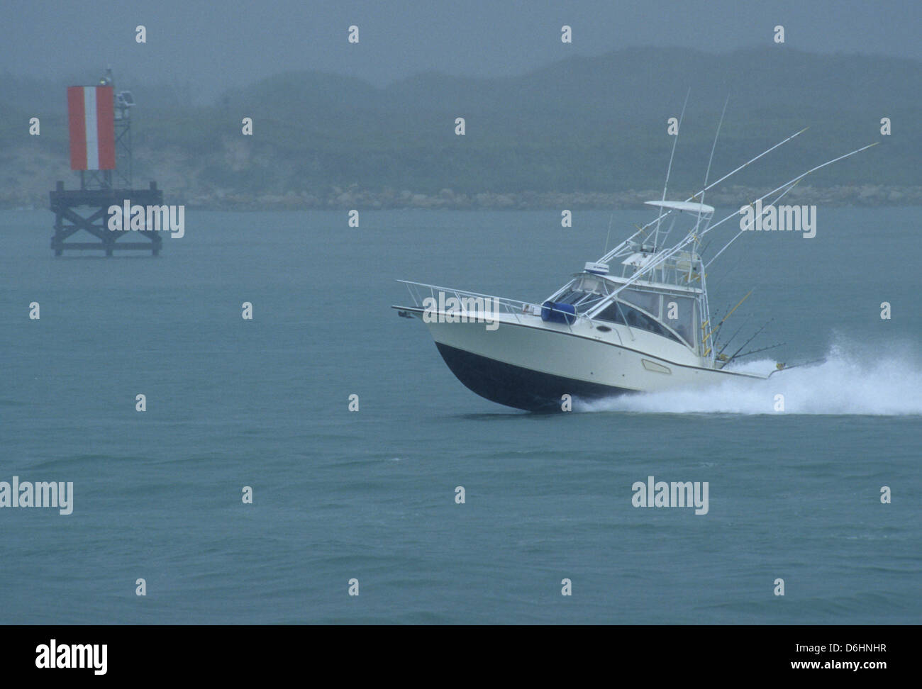 Offshore sport fishing boat returning to the harbor in - Private deep sea fishing port aransas ...