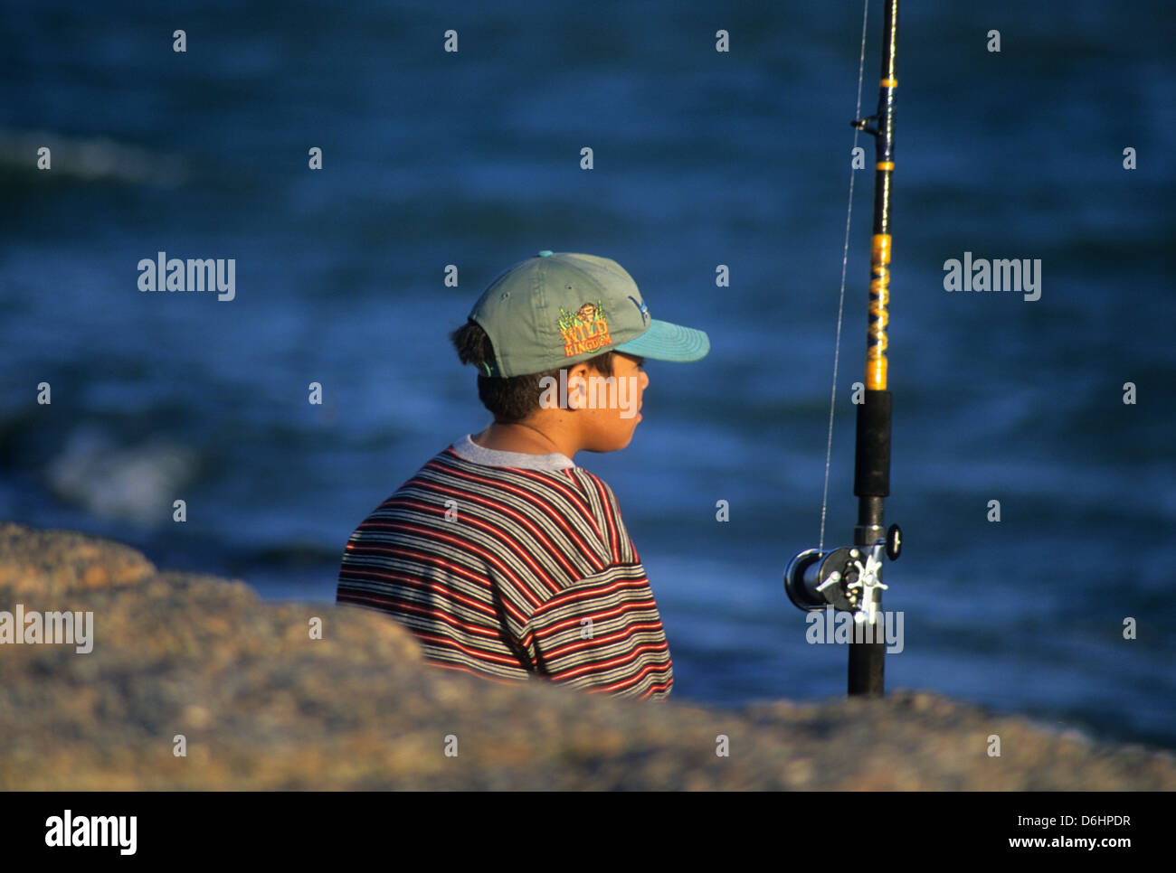 Young boy fishing on the jetties at port aransas texas for Port aransas jetty fishing report