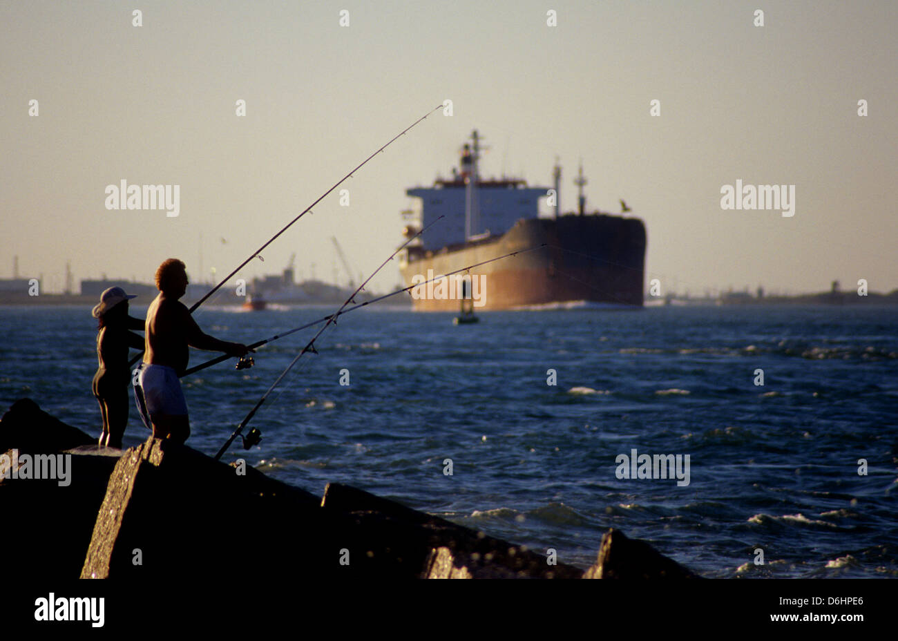 Man and woman fishing on the jetties at port aransas texas for Port aransas jetty fishing report