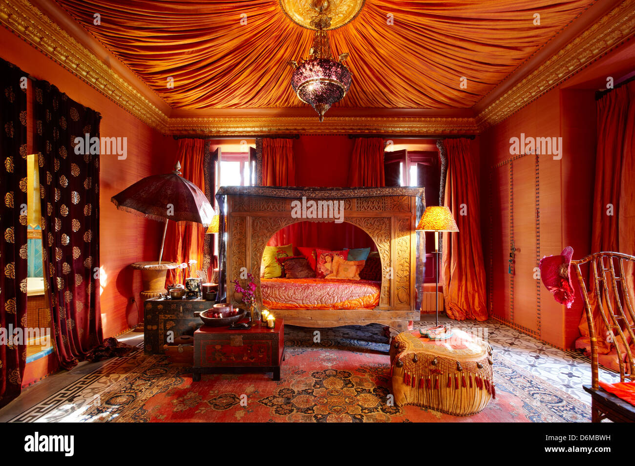 Red room indian asian exotic carved bedroom stock photo for Interior design jungle room