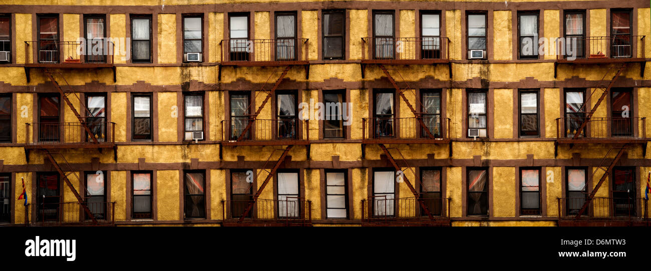 Many windows and fire escapes of a New York city apartment