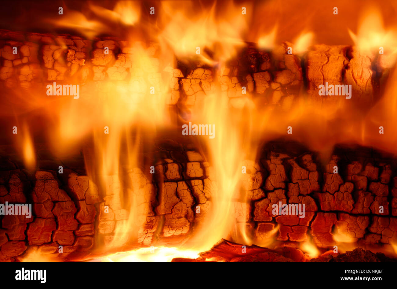 fire flames from burning wood logs in a high efficiency fireplace