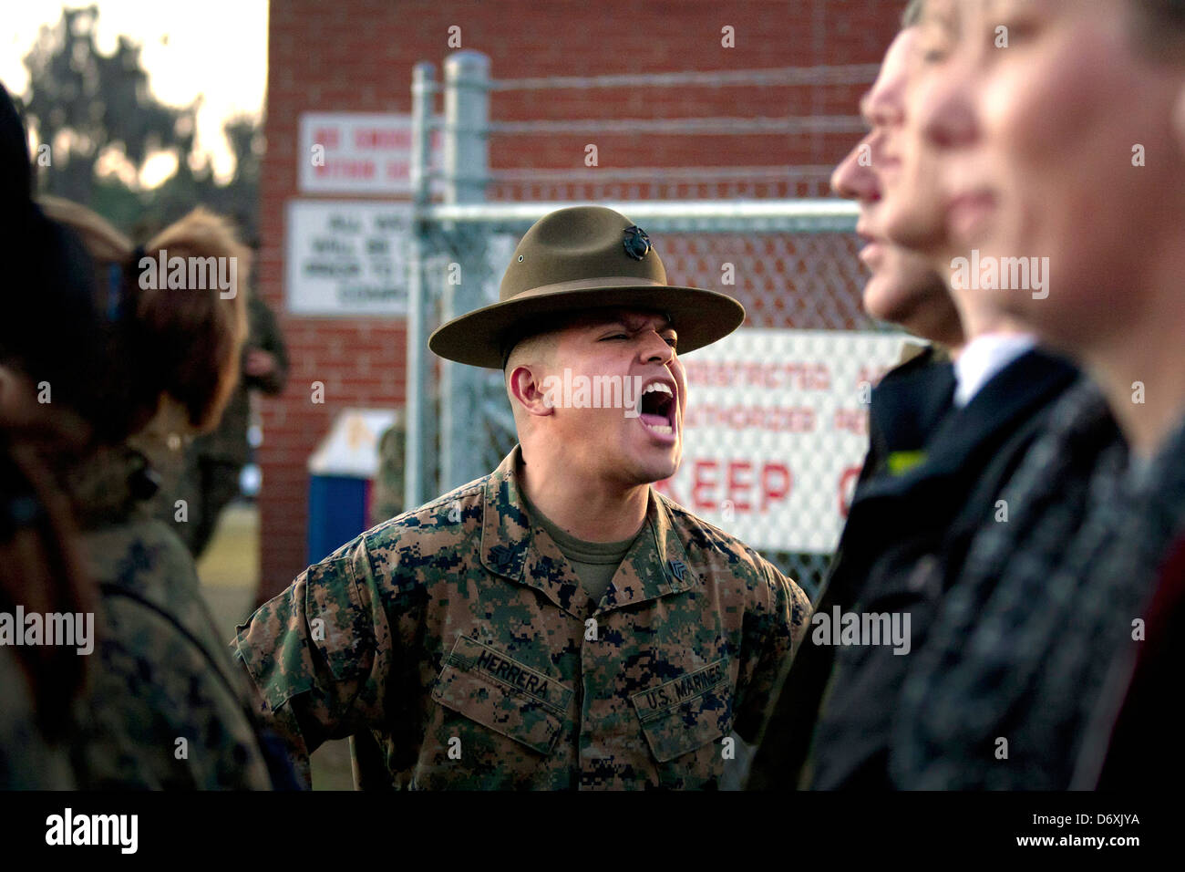 A Us Marine Corps Drill Instructor Gives A Group Of South Florida ...