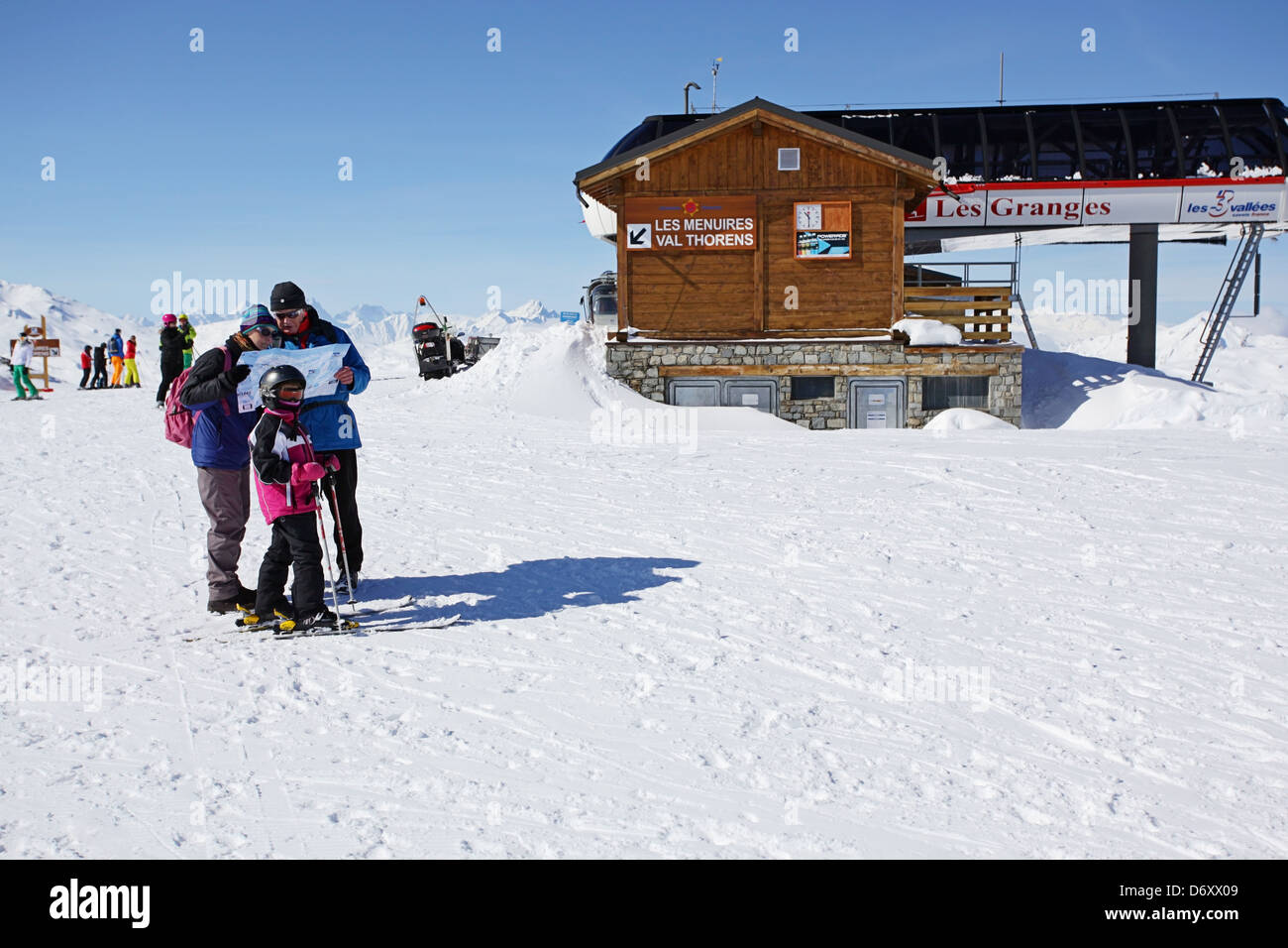Family reading a map at Les Granges Skiing in the Alps France