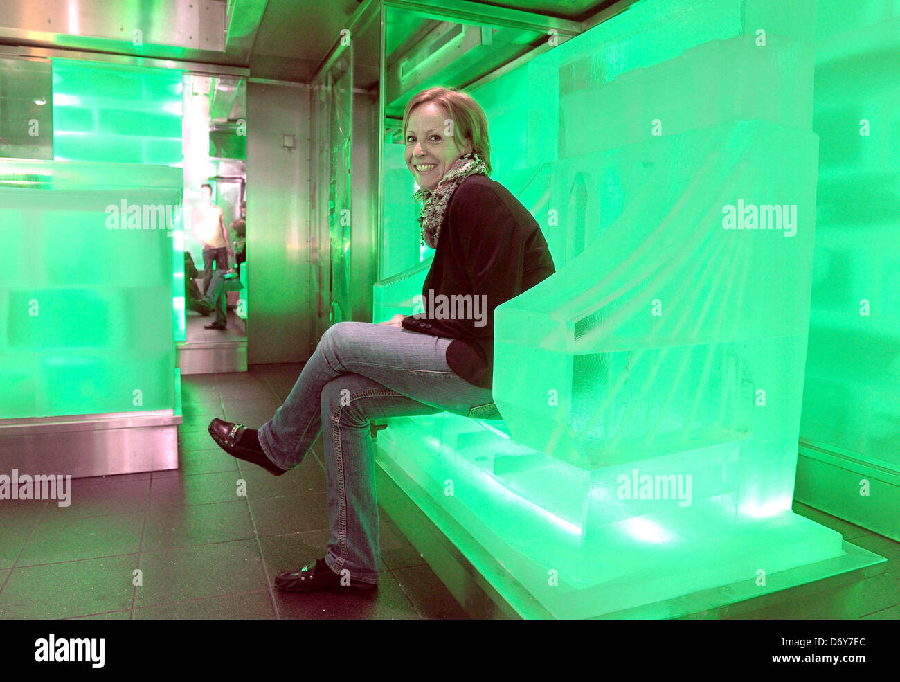 A NCL Employee Sits In The IceBar Which Completely Consits Of - Ice bar on cruise ship