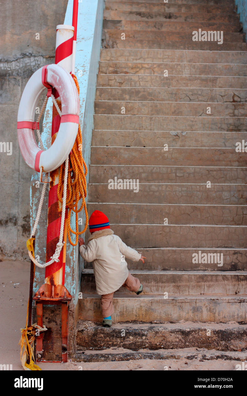 Taiwan, Kinmen County, Jincheng, Boy Climbing Beach Access Stairs