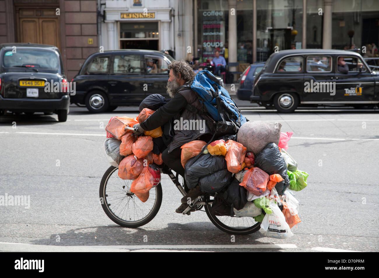 Tramp bag man bagman cycling through london weighed down ...