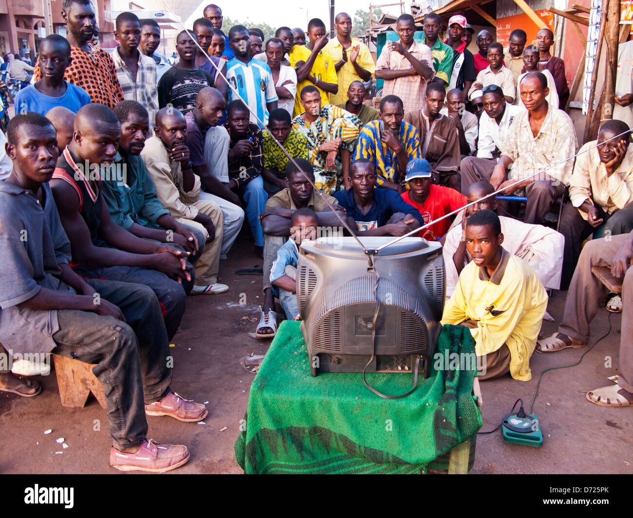 A group of local people watching the african cup on tv in for People watching